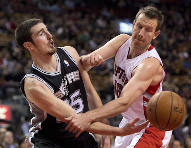 San Antonio Spurs guard Nando De Colo, left, passes the ball past Toronto Raptors forward Steve Novak (16) during the second half of an NBA basketball game in Toronto on Tuesday, Dec. 10, 2013