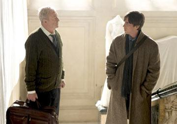Michael Caine as Alfred Pennyworth and Christian Bale as Bruce Wayne in Warner Bros. Pictures' Batman Begins