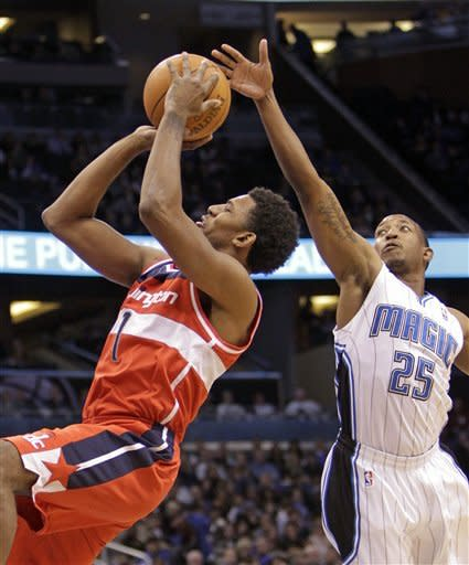 Howard, Magic run past winless Wizards, 103-85