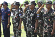 Philippine military and Coast Guard troops salute during welcome rites for Filipino lawmakers at Pag-asa Island, part of the disputed Spratly group of islands, in the South China Sea located off the coast of western Philippines on Wednesday July 20, 2011. A group of Filipino lawmakers flew Wednesday to the Philippine-occupied island in the disputed South China Sea to assert their country&#39;s claim to the potentially oil-rich region in defiance of China&#39;s protest that the visit threatens regional stability. (AP Photo/Rolex Dela Pena, Pool)
