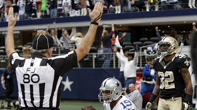 Dallas Cowboys wide receiver Miles Austin (19) scores a touchdown as New Orleans Saints defensive back Johnny Patrick (32) reacts during the second half of an NFL football game on Sunday, Dec. 23, 2012, in Arlington, Texas. (AP Photo/Brandon Wade)