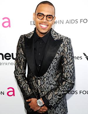 Chris Brown Flirts With Women at Elton John's Oscar Party, Attends Without Rihanna