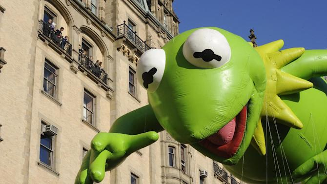 The Kermit The Frog balloon makes its way down New York's Central Park West in celebration of the 86th annual Macy's Thanksgiving Day Parade,Thursday, Nov 22, 2012. (AP Photo/ Louis Lanzano)