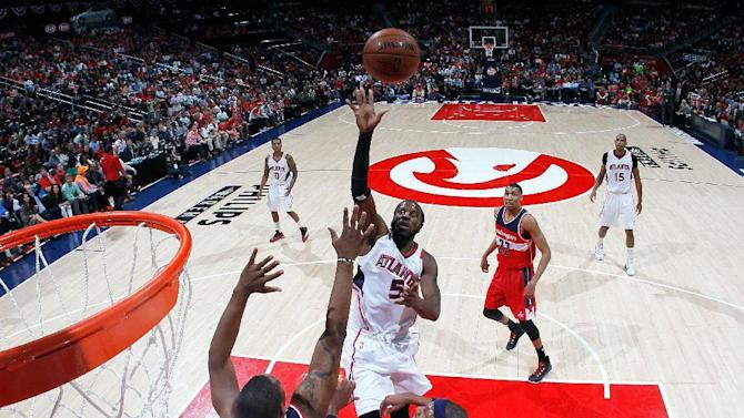 Atlanta Hawks' DeMarre Carroll shoots over Washington Wizards' Kevin Seraphin and Paul Pierce during Game Two of the Eastern Conference semi-finals at Philips Arena on May 5, 2015