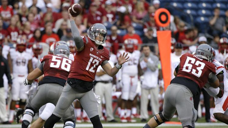 Washington State quarterback Connor Halliday passes against Rutgers in the first half of an NCAA college football game, Thursday, Aug. 28, 2014, in Seattle