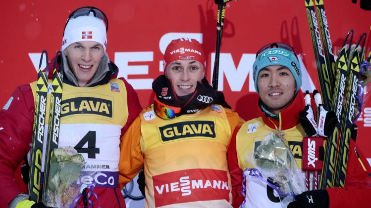 Top three finishers stand on the podium after the FIS World Cup Nordic Combined Cross Country in Lillehammer