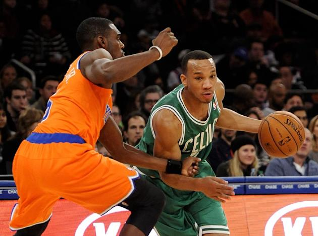 Boston Celtics' Avery Bradley right,  drives the ball around New York Knicks' Tim Hardaway Jr.  during the second half of an NBA basketball game on Sunday, Dec. 8, 2013, in New York. The Celti