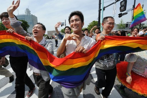 Participants are seen carrying a rainbow flag as they march during the Tokyo Rainbow Pride 2012, in Shibuya district, in April. Some 1,000 gays, lesbians and their supporters took part in the parade. (AFP Photo/Toru Yamanaka)