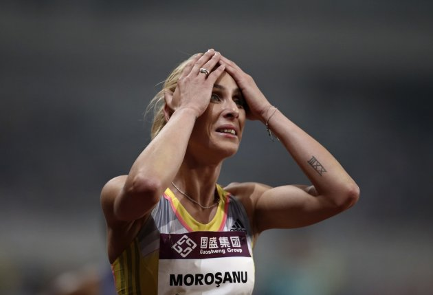 Morosanu of Romania reacts after the women's 400 meters hurdles at the IAAF Diamond League Athletics meet in Shanghai
