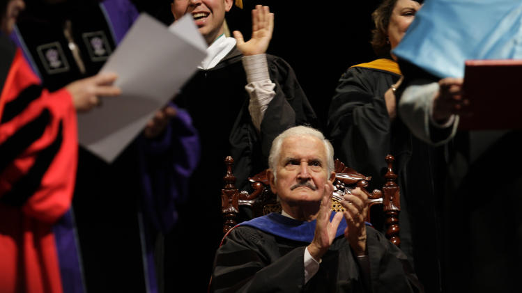 FILE - In this March 26, 2010 file photo, Mexican writer Carlos Fuentes applauds after receiving an honorary doctorate from the University of Puerto Rico in San Juan, Puerto Rico. Fuentes, Mexico's most celebrated novelist and among Latin America's most prominent authors, died on May 15, 2012. (AP Photo/Andres Leighton, File)