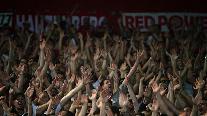 Bayern Munich's supporters cheer before a football match in Athens on September 16, 2015