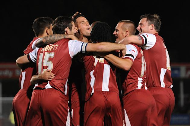 Darren Carter, left centre, scored both of Cheltenham's goals against Morecambe