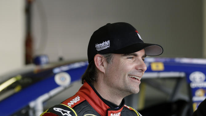 Jeff Gordon laughs with crew members in his garage after a practice session for the NASCAR Daytona 500 Sprint Cup Series auto race at Daytona International Speedway, Friday, Feb. 22, 2013, in Daytona Beach, Fla. (AP Photo/John Raoux)