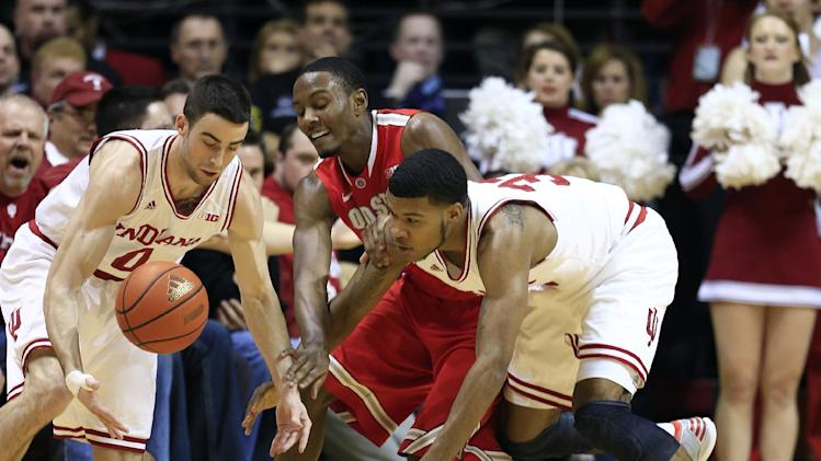 Indiana's Will Sheehey, left, and Jeremy Hollowell, right, battle for a loose ball against Ohio State's Sam Thompson during the first half of an NCAA college basketball game, Tuesday, March 5, 2013, in Bloomington, Ind. (AP Photo/Darron Cummings)