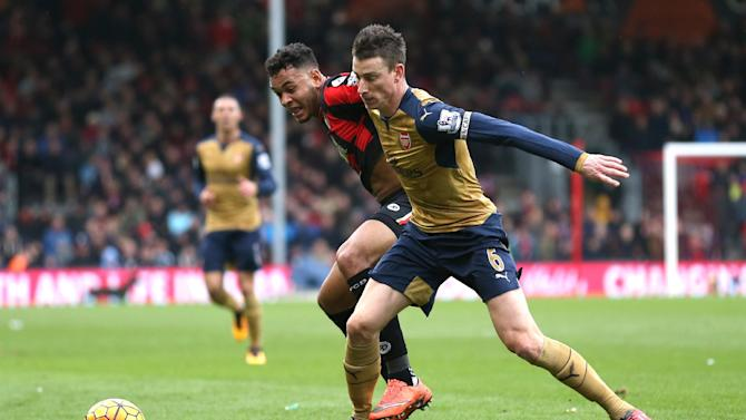 Bournemouth's Joshua King in action with Arsenal's Laurent Koscielny