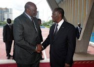 Mali&#39;s interim premier Cheick Modibo Diarra (left) is welcomed by Ivorian President Alassane Ouattara before a meeting at Abidjan&#39;s presidential palace. Ouattara is the head of the West African bloc ECOWAS. Mali&#39;s embattled transitional government has rejected a rebel alliance&#39;s declaration of an Islamic state in the vast desert north, a move that has plunged the nation closer to breakup