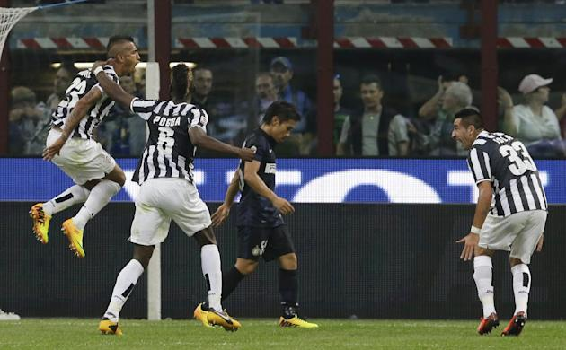 Juventus midfielder Arturo Vidal, of Chile, left, jumps in celebration after scoring while teammates Juventus midfielder Paul Pogba, of France  back to camera, and Juventus midfielder Mauricio Isla, o