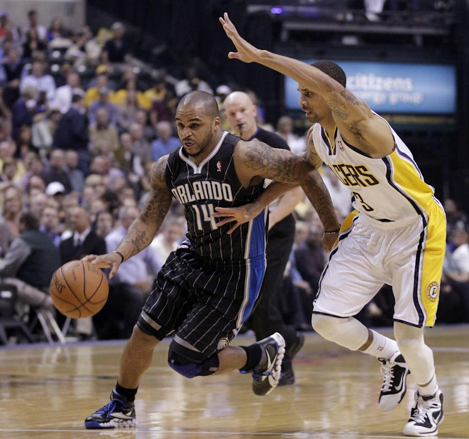 Indiana Pacers guard George Hill, right, defends Orlando Magic guard Jameer Nelson in the first half of an NBA first-round playoff basketball game in Indianapolis, Monday, April 30, 2012. (AP Photo/Michael Conroy)