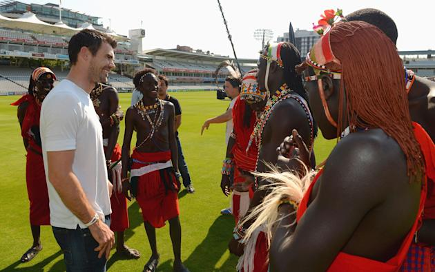 LONDON, ENGLAND - SEPTEMBER 04:  James Anderson of England meets the Maasai Warriors Cricket Team during the Last Man Standing Finals at Lords on September 4, 2013 in London, England.  (Photo by Chris