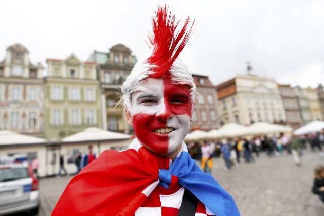 A Croatian soccer fan poses for a picture in downtown Poznan