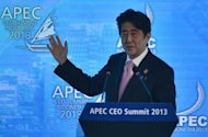 Japan's Prime Minister Shinzo Abe gives a speech during the Asia-Pacific Economic Cooperation summit on Bali on October 7, 2013