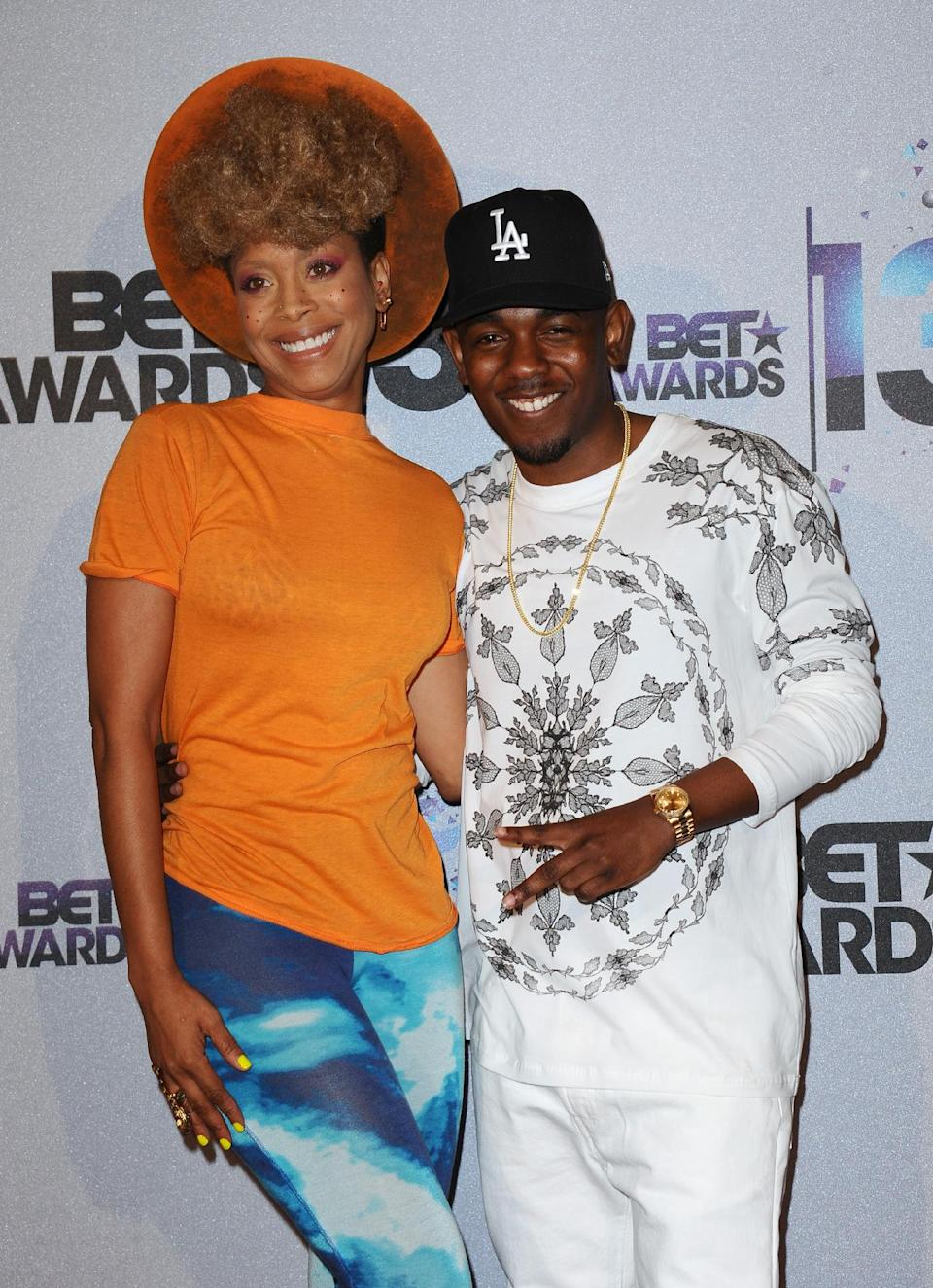 Erykah Badu, left, and Kendrick Lamar pose backstage at the BET Awards at the Nokia Theatre on Sunday, June 30, 2013, in Los Angeles. (Photo by Scott Kirkland/Invision/AP)