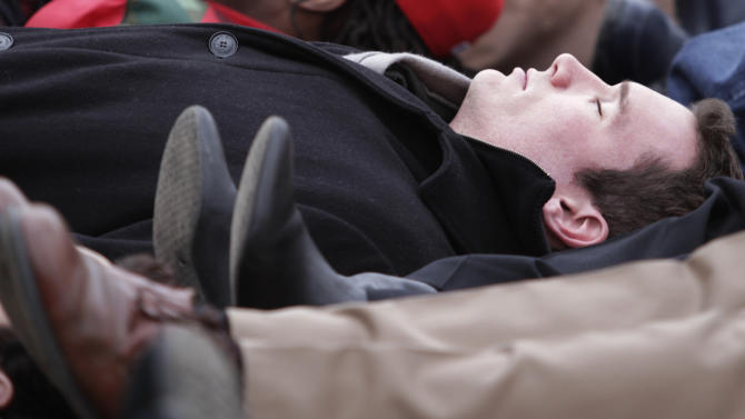 FILE - In this Jan. 17, 2011 file photo, Virginia Tech shooting survivor Colin Goddard participates in a lie-in during a rally protesting gun violence in Richmond, Va. The divide between those who favor gun control and those who don't has existed for decades, separating America into hostile camps of conservative vs. liberal, rural vs. urban. As the nation responds to the massacre of 20 children and six adults in Newtown, Conn., the gulf has rarely felt wider than now. (AP Photo/Steve Helber, File)