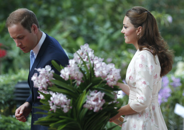 Britain's Prince William and his wife Kate, the Duke and Duchess of Cambridge, view a hybrid orchid named in their honor while touring the Orchid Garden within the Singapore Botanical Gardens in Singapore, on Tuesday, Sept. 11, 2012. The British royal couple are on an official three-day trip to Singapore. (AP Photo/Stephen Morrison, Pool)