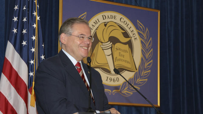 """In this Jan. 31, 2010, image released by Miami Dade College, shows Sen. Robert Menendez, D-N.J., speaks at the signing of his book """"Growing American Roots"""" at the college in Miami. Menendez sponsored legislation with incentives for natural gas vehicles conversions that would benefit the biggest political donor to his re-election, Dr. Salomon Melgen, the same eye doctor whose private jet Menendez used for two personal trips to the Dominican Republic, an Associated Press investigation found. (AP Photo/Miami Dade College, Phil Roche)"""