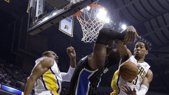 Orlando Magic forward Glen Davis, center, is fouled by Indiana Pacers forward Danny Granger, right, as Pacers guard Leandro Barbosa watches during the first half of the second game of an NBA first-round playoff basketball series, in Indianapolis on Monday, April 30, 2012. (AP Photo/Michael Conroy)