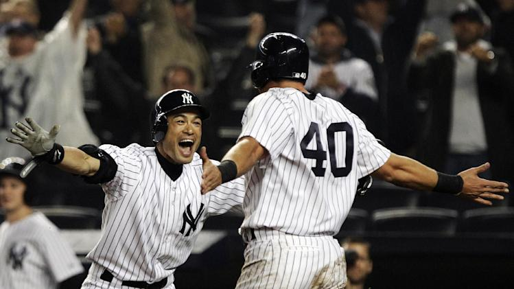 New York Yankees' Ichiro Suzuki, left, of Japan, celebrates with Francisco Cervelli (40) after Cervelli scored on an RBI single from Raul Ibanez during the 12th inning of a baseball game, Tuesday, Oct. 2, 2012, in New York. The Yankees won 4-3. (AP Photo/Frank Franklin II)