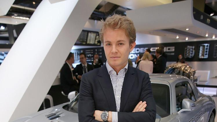 IMAGE DISTRIBUTED FOR IWC SCHAFFHAUSEN  -  Nico Rosberg visits the IWC booth during the Salon International de la Haute Horlogerie (SIHH) 2013 at Palexpo in Geneva, Switzerland, on Jan. 22, 2013. (Chris Jackson/Photopress for IWC via AP Images)