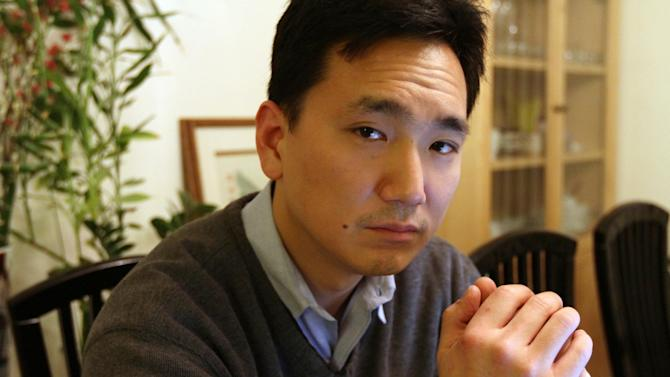 In this Jan. 20, 2012 photo, Daniel Kim poses for a photograph at his home in the Queens borough of New York. Kim is a former U.S. Army Staff Sergeant. Kim is a 39-year-old Korean-American who spent 12 years in the infantry before leaving the service in 2004. (AP Photo/Tina Fineberg)