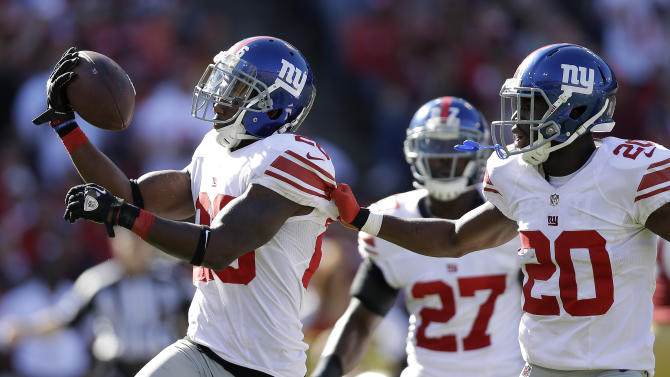 New York Giants free safety Antrel Rolle, left, celebrates with cornerback Prince Amukamara (20) after intercepting San Francisco 49ers quarterback Alex Smith during the third quarter of an NFL football game in San Francisco, Sunday, Oct. 14, 2012. (AP Photo/Marcio Jose Sanchez)