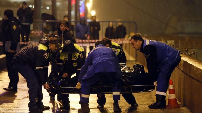 Medics lift the body of Boris Nemtsov, who was shot dead, in central Moscow