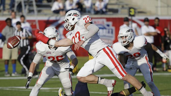 Southern Oregon linebacker Heston Altenbach (22) tries but can't make an interception against Marian during the first half of an NAIA Football National Championship game in Daytona Beach, Fla., Friday, Dec. 19, 2014