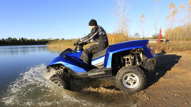 In this Friday, Oct. 12, 2012  photo, the Quadski, a one-person motor boat that also drives on land, is tested in  in Oxford Mich. The vehicle is being billed as the first commercially available, high-speed amphibious vehicle by its makers, Michigan-based Gibbs Technologies.  It's scheduled to go on sale in the U.S. by the end of this year for around $40,000. The company hopes to sell it worldwide by 2014. (AP Photo/Carlos Osorio)
