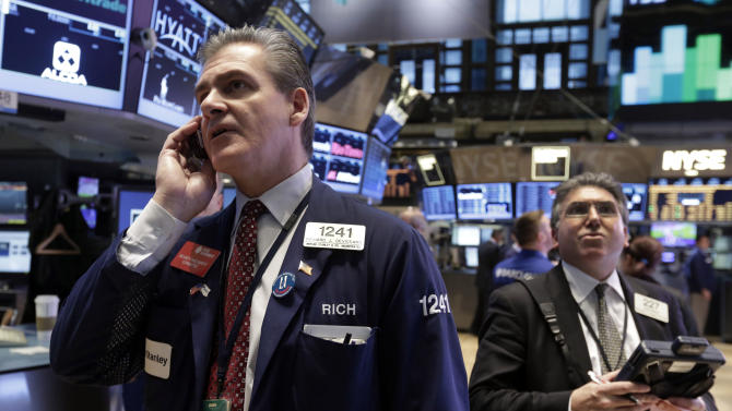 In this Tuesday, Feb. 5, 2013 photo, Richard Deviccaro, left, works with fellow traders on the floor of the New York Stock Exchange. (AP Photo/Richard Drew)