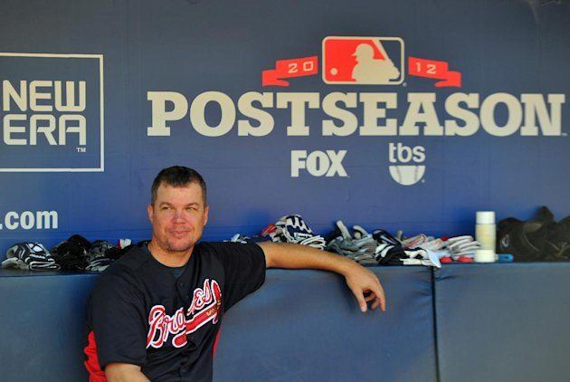 Atlanta Braves' Chipper Jones takes a break in the dugout batting practice at Turner Field Thursday, Oct. 4, 2012, in Atlanta. The Braves take on St. Louis Cardinals in the NL wild-card baseball game on Friday. (AP Photo/Atlanta Journal-Constitution, Brant Sanderlin) MARIETTA DAILY OUT; GWINNETT DAILY POST OUT; LOCAL TV OUT; WXIA-TV OUT; WGCL-TV OUT