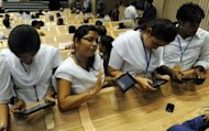 "Indian students use the newly launched ""Akash"" the 46 USD (34 euros) computer tablet in New Delhi. India launched its long-awaited ""computer for the masses"", unveiling a 46 USD tablet device designed to bring the information technology revolution to tens of millions of students"