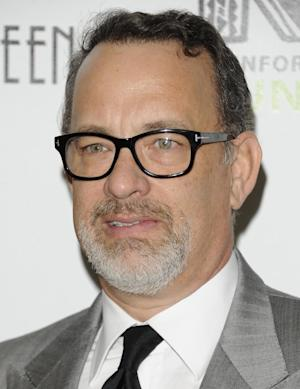 FILE - In this April, 3 ,2012 file photo actor Tom Hanks attends the Revlon Concert for the Rainforest Fund dinner in New York. A Southern California insurance broker was arrested Wednesday, Nov. 7, 2012, on allegations he overcharged Hanks, musician Andy Summers and others hundreds of thousands of dollars for insurance premiums. (AP Photo/Evan Agostini, File)