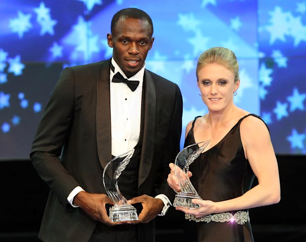"Jamaican sprinter Usain Bolt, left, and Australian hurdler Sally Pearson stand with their ""Athlete of the Year Awards"", Saturday, Nov. 12, 2011, in Monaco, awarded by the International Athletic Founda"