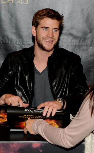 Liam Hemsworth of Lionsgate's 'The Hunger Games' signs autographs at Barnes & Noble at The Grove in Los Angeles on March 22, 2012 -- Getty Images