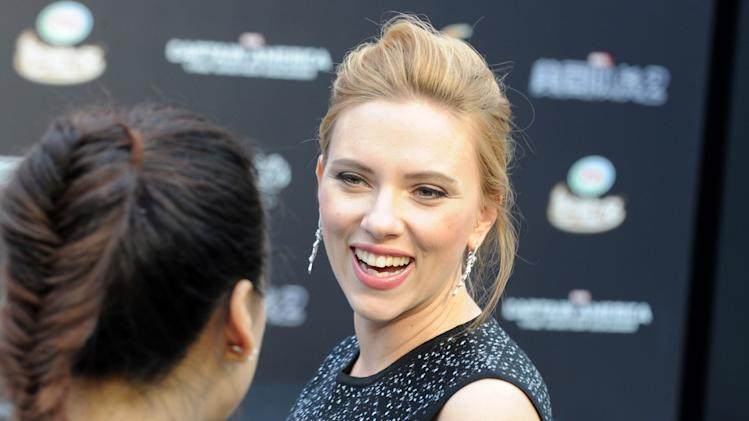 "US actress Scarlett Johansson arrives at a press conference for the film ""Captain America: The Winter Soldier"" at a shopping mall in Beijing on March 24, 2014"