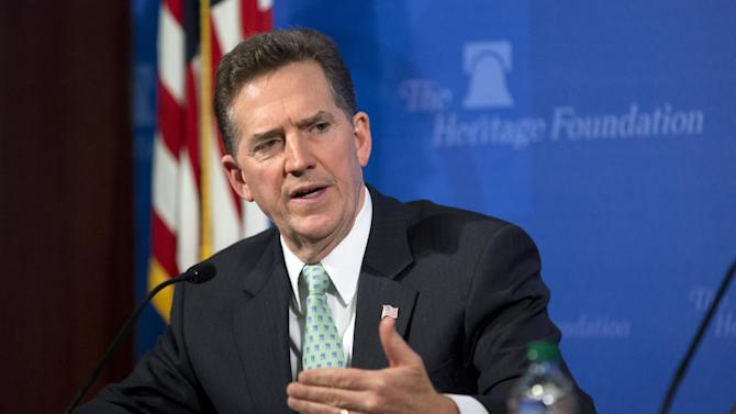 Jim DeMint, president of the Heritage Foundation, gestures during a news conference on immigration reform Monday, May 6, 2013, in Washington. The Heritage Foundation presented a study that immigration legislation would cost taxpayers $6.3 trillion to provide government benefits for millions of people now living in the U.S. illegally. Supporters of the legislation call the study deeply flawed. (AP Photo/Evan Vucci)