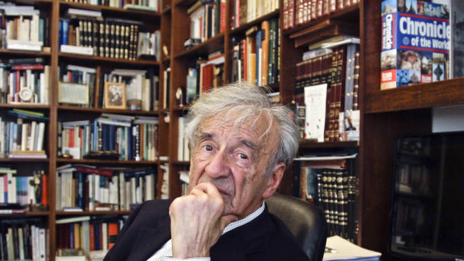 """This Sept. 12, 2012, photo shows Holocaust activist and Nobel Peace Prize recipient Elie Wiesel, 83, in his office in New York.  Weisel's latest book is titled, """"Open Heart.""""  (AP Photo/Bebeto Matthews)"""