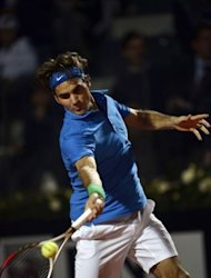 Swiss Roger Federer returns the ball to Italian Andreas Seppi during the Italian Open Tennis Tournament in Rome&#39;s Foro Italico. Federer won 6-1, 6-2