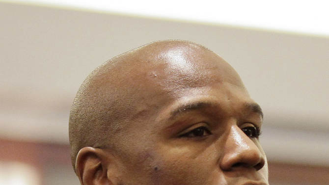 FILE - This Dec. 21, 2011 file photo shows boxer Floyd Mayweather Jr.,  waiting for sentencing in Clark County District Court, in Las Vegas. Champion boxers Mayweather Jr. and Manny Pacquiao have reached a confidential settlement, Tuesday Sept. 25, 2012, in their federal defamation case in Las Vegas. Attorneys for all sides say the terms won't be disclosed.  (AP Photo/Julie Jacobson, File)