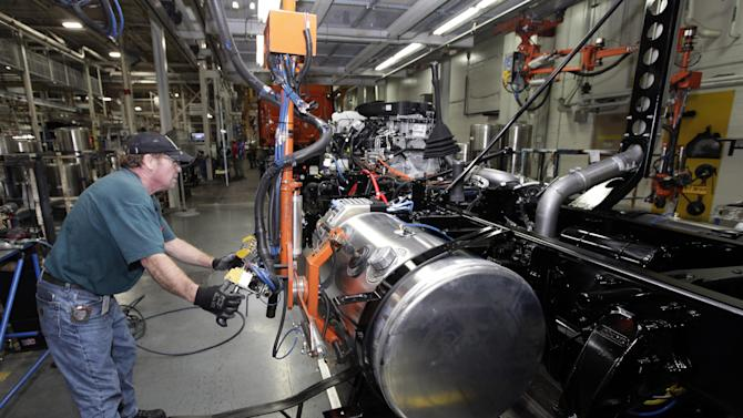 FILE- In this Thursday, Jan. 12, 2012, file photo, Thomas Warren installs a fuel cell on a Freightliner truck at a plant in Cleveland, N.C. U.S. worker productivity fell by the largest amount in a year from January through March, the Labor Department reported Wednesday, June 6, 2012. Productivity fell at an annual rate of 0.9 percent in the first quarter. (AP Photo/Chuck Burton, File)