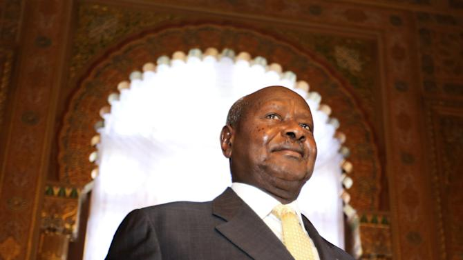 Ugandan President Yoweri Museveni walks out after speaking to reporters at the Akasaka Palace state guesthouse in Tokyo Saturday, Sept. 12, 2015. Museveni said Islamic extremists in Somalia may have taken some of his country's troops as prisoners after a recent attack on an African Union base there. He said that 19 soldiers were killed and six were missing following the Sept. 1 attack. He blamed the laxity of the Ugandan commanders for the losses. (AP Photo/Eugene Hoshiko)